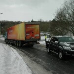 Driver manages to tow huge truck up hill on icy roads