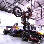 Motorcycle ace jumps Formula One car