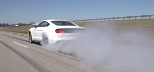 Still from a video showing the Mustang GT using the line-lock feature.