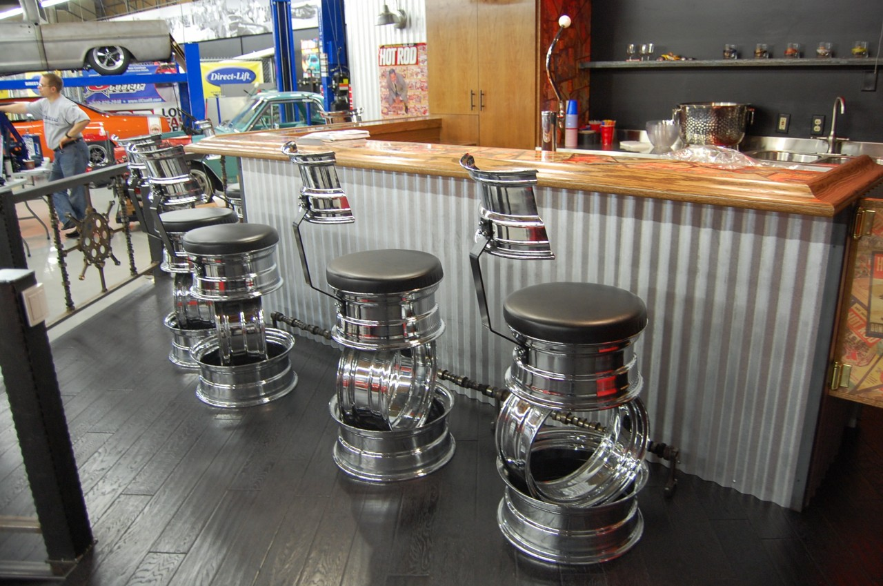 This bar with stools made out of tire rims camshaft footrests and a
