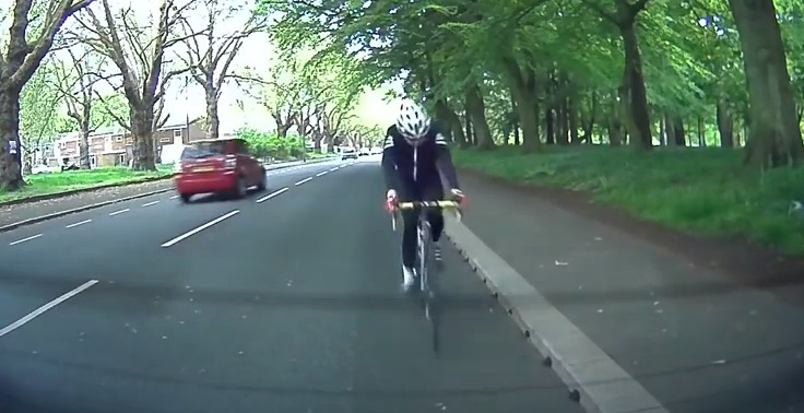 Daydreaming cyclist rear-ends stationary car – ouch!