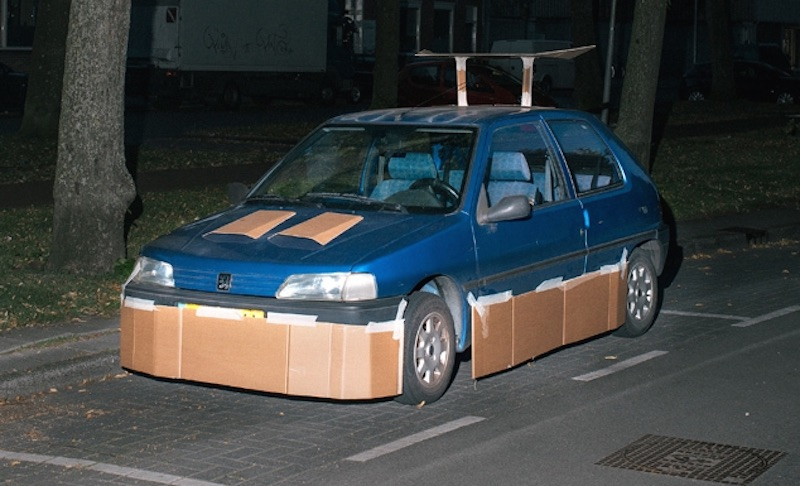 This Guy Pimps Random Cars With Cardboard At Night