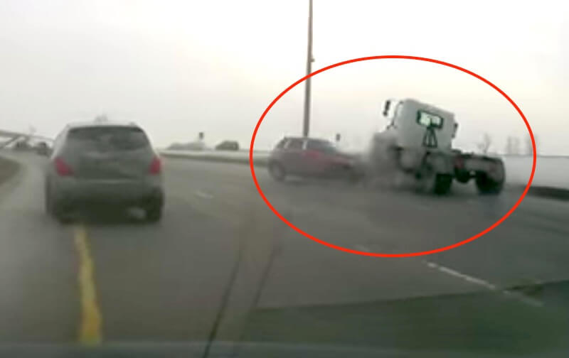 Horror 'black ice' crash as SUV hits truck head-on: Video