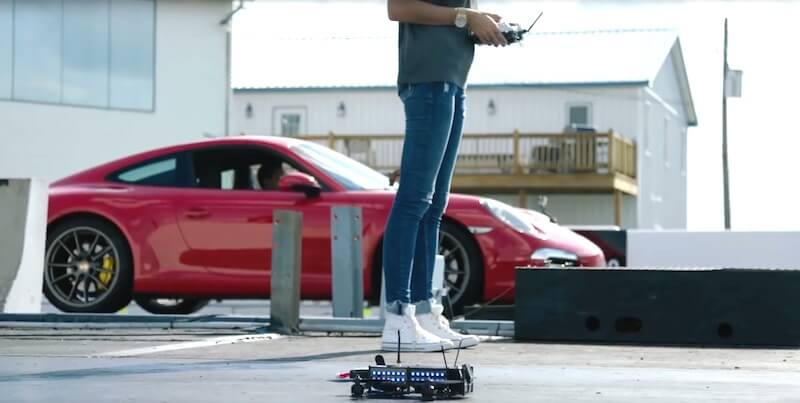 Watch a drone race the Porsche 911. This is INSANE!